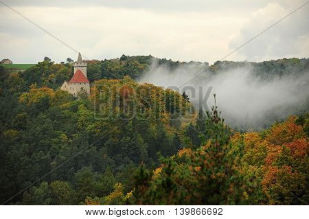 Kokorin Castle in the beautiful autumn forest in Czech Republic