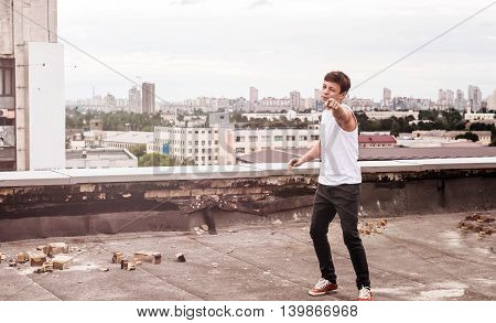 teenager on the roof of a tall building in the city center