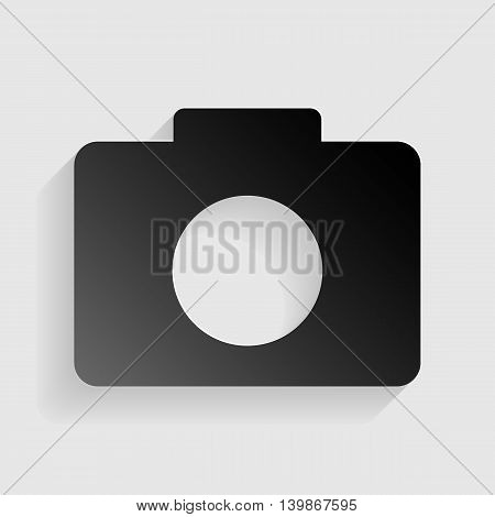 Digital camera sign. Black paper with shadow on gray background.