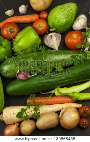 Various types of vegetables on an old wooden table. Sales of fresh vegetables. Dietary supplements for athletes.