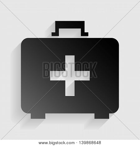 Medical First aid box sign. Black paper with shadow on gray background.