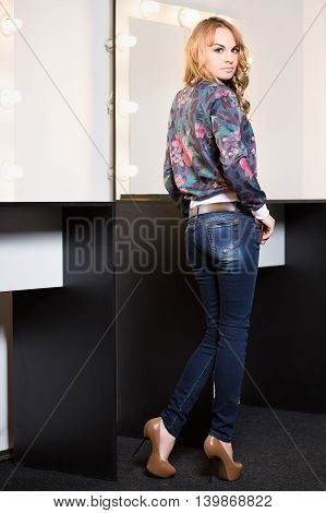 Beautiful young woman wearing fashionable color clothes