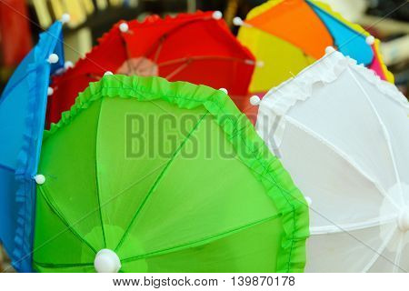 set of decorative colored umbrellas in the open position