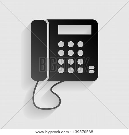 Communication or phone sign. Black paper with shadow on gray background.