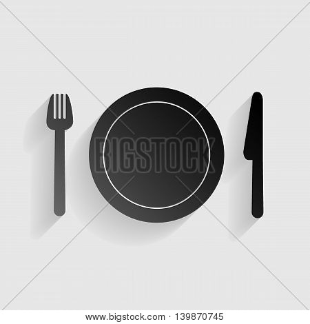 Fork, plate and knife. Black paper with shadow on gray background.
