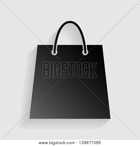 Shopping bag illustration. Black paper with shadow on gray background.