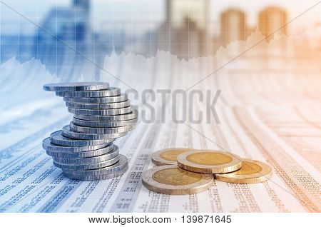 Business Concept, Coin Stacks On News Paper With Financial Graph Stat Business Background.