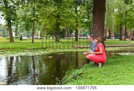 Pregnant Woman  With Her Husband In Park