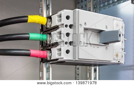 Powerful block electrical circuit breaker. Mounted in the electrical cabinet.