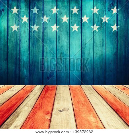 Empty wooden deck table over USA flag background. USA national holidays. Ready for product display montage.