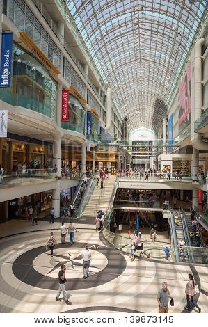 Toronto - 4 July 2016: Shoppers Visit Eaton Center Mall In Toronto.