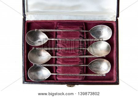 Sets of vintage silverware, including tea spoons