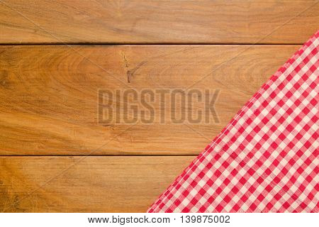 Background with wooden tabletop and checked tablecloth