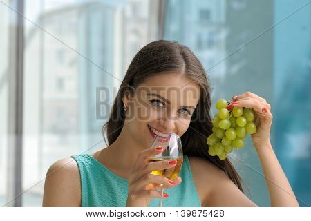 Girl Drinking White Wine And Smiling