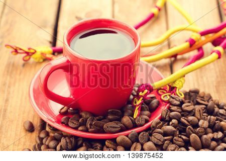Espresso coffee cup with coffee beans on wooden table
