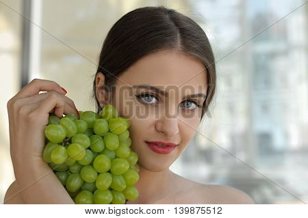 Girl Is Holding A Bunch Of Ripe Grapes In Her Hands