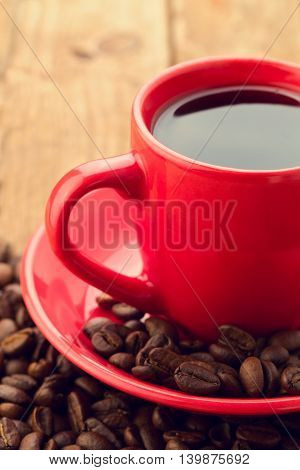 Close up of coffee cup with coffee beans