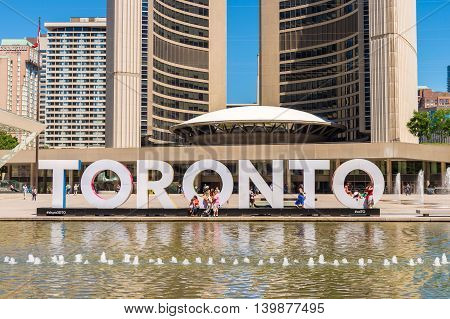 Toronto CA - 4 July 2016: 3D Toronto sign and Nathan Phillips Square in Toronto Canada
