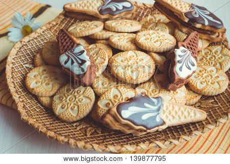 Cookies stacked up on a plate ready to be served