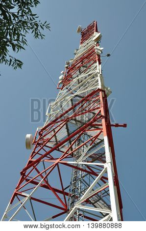 Telecommunication tower against the blue , clear sky