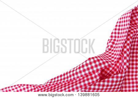 red folded picnic tablecloth isolated on white