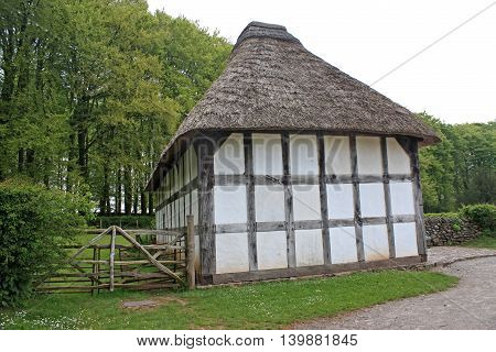Black and white timber framed thatched cottage