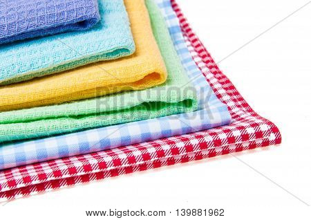multicolor tablecloth isolated on white, violet, blue yellow and red
