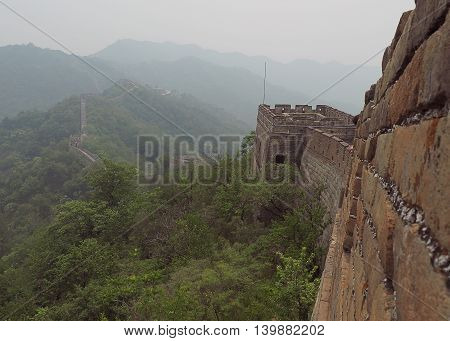 Beijing Province, China - June 09, 2016: Abyss Chinese wall. Chinese mur- ancient defensive structure surrounded by mountains on the border of China.