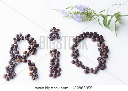 Coffee beans arranged shaped RIO heart on wood