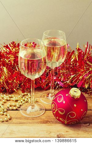 Christmas holiday celebration with glass of champane and ornamnets