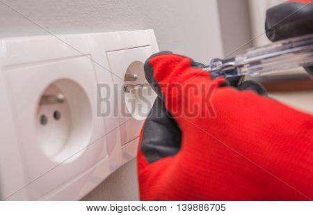 Fixing Electric Socket Closeup Photo. European Electric Socket.