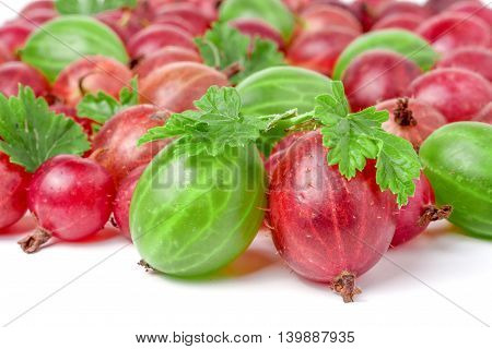 red and green gooseberries with leaves isolated on white background.