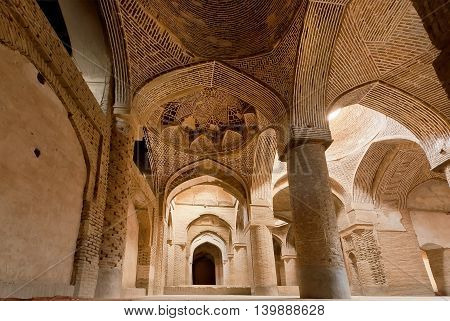 Columns of historical Jameh Mosque of Isfahan, Iran. Isfahan is example of Islamic culture