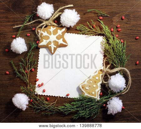 flat lay New Year's congratulatory background with figured ginger cookies and decorations / happy Christmas mood