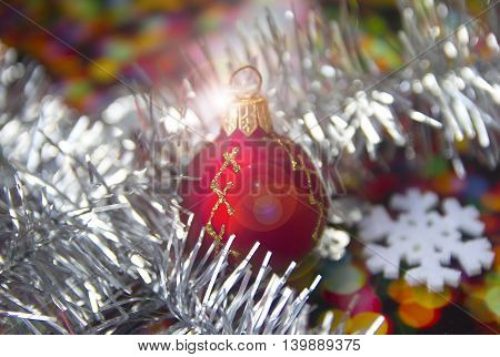 bright Christmas balls with reflections and colored tinsel