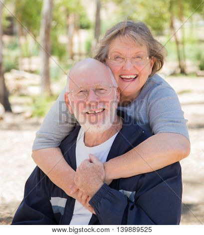 Happy Senior Couple Portrait Outdoors At Park.