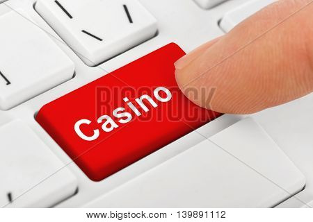 Computer notebook keyboard with Casino key - technology background