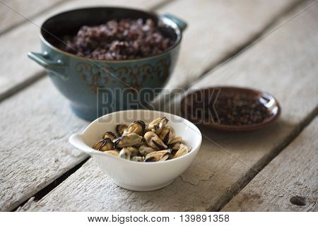 Mussels and black rice in the turquoise tureen