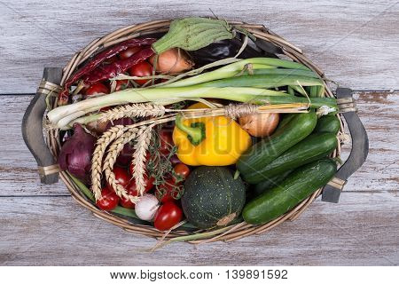 seasonal vegetables on a rustic wooden background