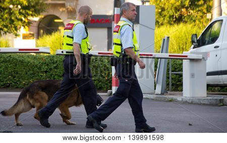 Frankfurt am Main, Germany - July 25, 2016: Security Officers with dog in Frankfurt am Main railway station.