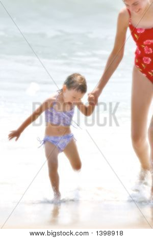 Happy Mom With Daughter On The Beach