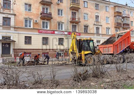 Nizhny Novgorod Russia. - April 26.2016. Municipal workers fall asleep fertile land had been brought to the place of the future flower beds