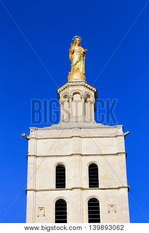 Virgin Mary statue at the famous Popes Palace square in Avignon, France