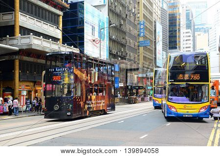 HONG KONG - NOV 9: Hong Kong Double deck buses on Des Voeux Road Central at the center of Financial District on Nov 9, 2015 in Hong Kong. Des Voeux Road is a major road on the north shore of Hong Kong