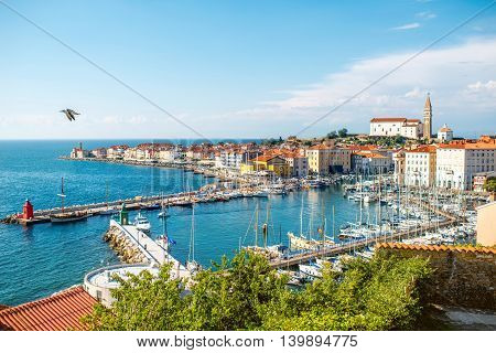 Piran, Slovenia - May 7, 2016: Top view on the gulf of Piran with old town center on the Adriatic sea. Piran is one of Slovenia's major tourist attractions.