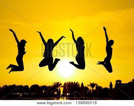 Evening Celebration Jumping over Sunset