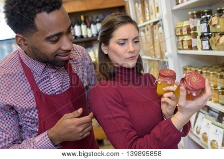meticulous customer reading the label