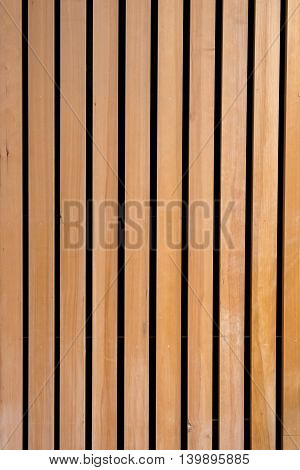 Vertical pattern in wood wall, light and dark stripes