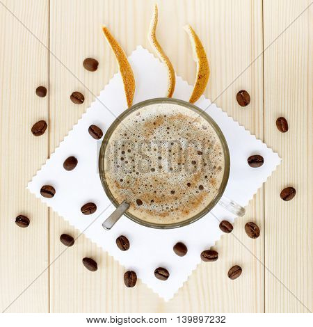 lay flat foam coffee cups decorated with seeds and crusts of citrus top view / cappuccino with citrus flavor