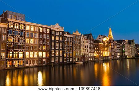 The traditional Dutch houses in evening Amsterdam Holland.